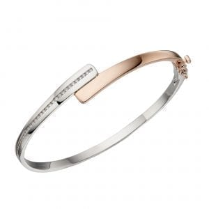 Channel set hinged bangle with rose gold
